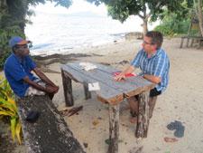 Kenneth Lango, Chairman of the Tasi Vanua Network, plans project activities with Adam Fraser, RESCCUE Vanuatu Coordinator