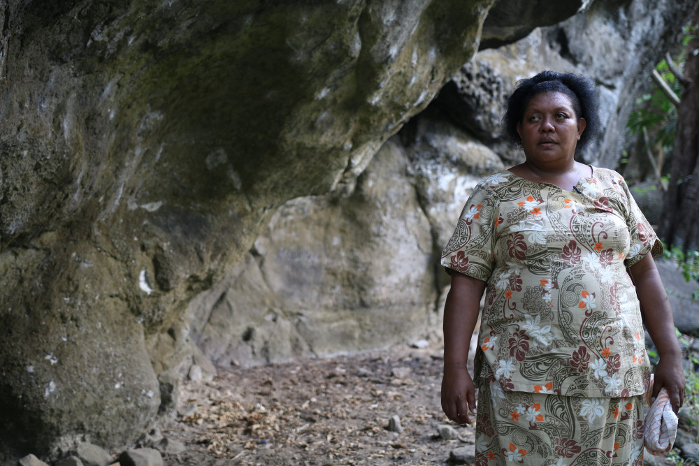 Vilimaina Ratu, Tukuraki village member, standing in front of the cave which sheltered her and her family from the brunt of Category Five Tropical Cyclone Winston